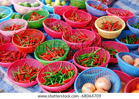 many of chili in basket in fresh market , Asia , Thailand