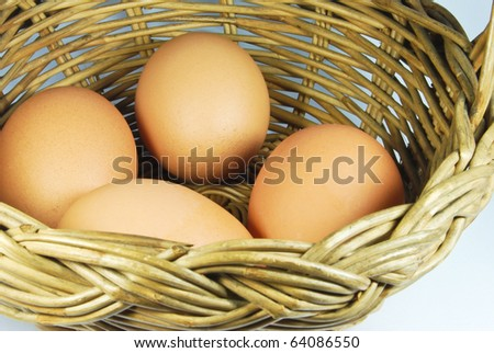 many of fresh eggs in vintage style basket