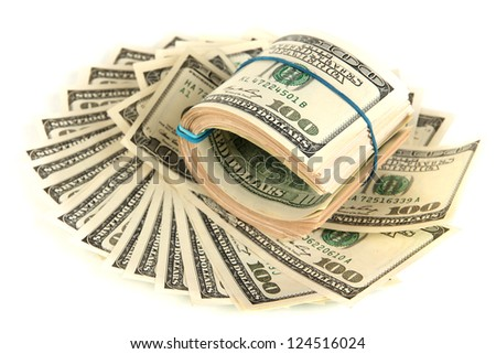 Many of one hundred dollars banknotes close-up isolated on white