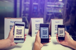 Many of people holdind and using smartphone to scan QR code for register. Scan QR code and Barcode for registration in to seminar event or meeting. The concept of electronic registration.