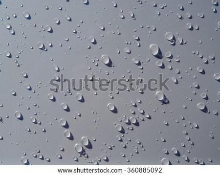Many of raindrops stuck on the Car Hood background,Abstract of raindrops on the Car Hood. #360885092