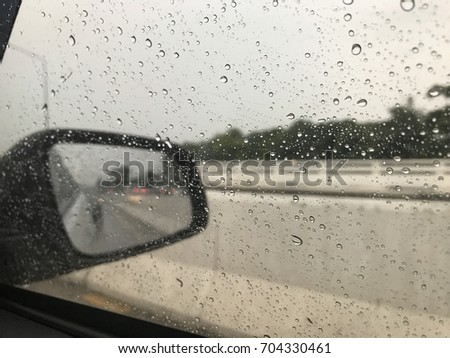 Many of raindrops stuck on the windshield background #704330461