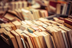 Many old books in a book shop or library. Shallow DOF