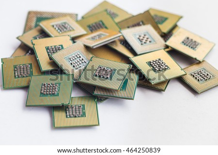 Stock Photo Many old CPU chips and obsolete computer processors as background
