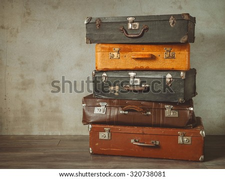 Many old suitcases stand in an empty room Stock photo ©