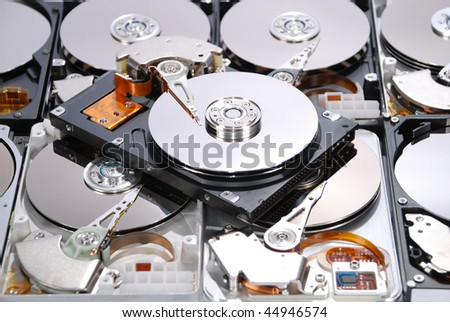 Many Open Hard drives isolated on white background