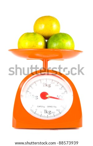 many orange lying on weight scale