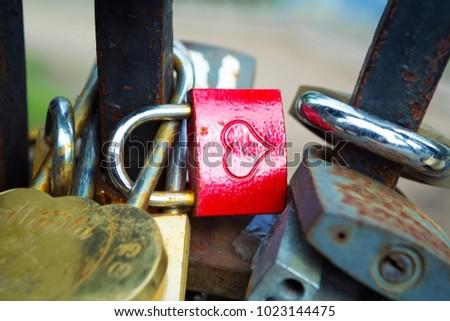Many padlocks of lovers wich hang on bridge railings #1023144475