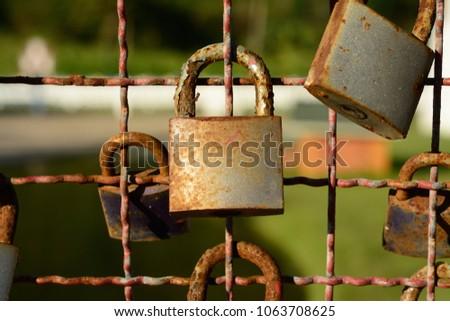 Many padlocks on the bridge railing, traditional marriage symbol #1063708625