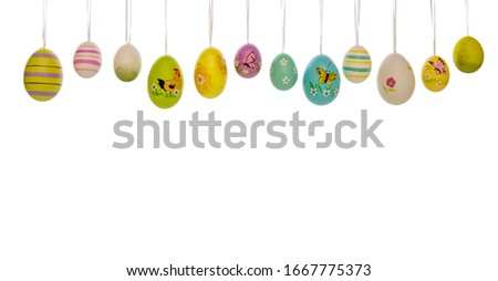 Many painted easter eggs hanging in a line on white background. Stok fotoğraf ©