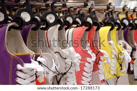 Many pair of sneakers in a store