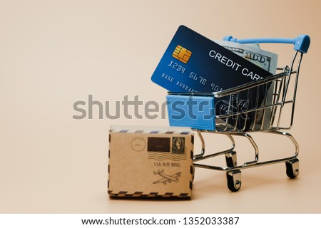 Many paper box money and cradit card in shopping