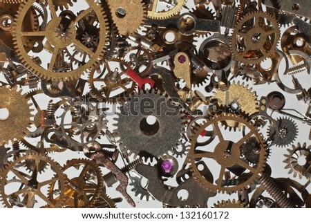 many parts and cog from a watch looking down from above background