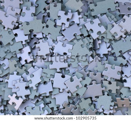 many parts of a disassembled puzzle