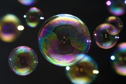 Many party soap bubbles isolated on black. Extremely detailed.