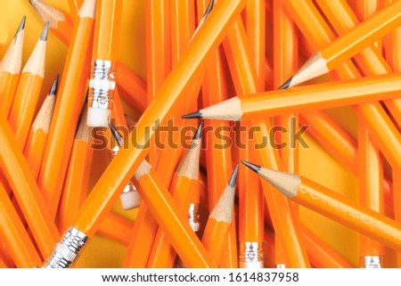 Many pencils piled in a big pile object