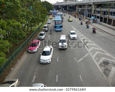 Many people and cars opposite the Northern Bus Terminal (Chatuchak) Bangkok Thailand after returning home on the day of Songkran holidays at 17th Tuesday April 2018. #1079861684
