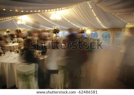 many people at a wedding reception in a marquee - Shutterstock ID 62486581