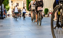 Many people in the city center in the pedestrian zonewho walk on foot and by bicycle