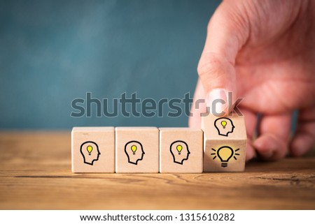 many people together having an idea symbolized by icons on cubes on wooden background #1315610282