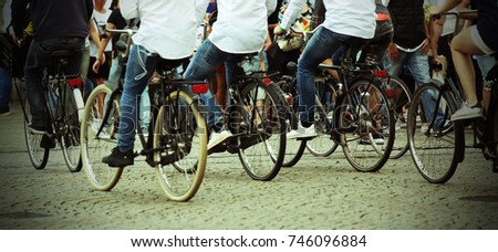 many people who ride bicycles...