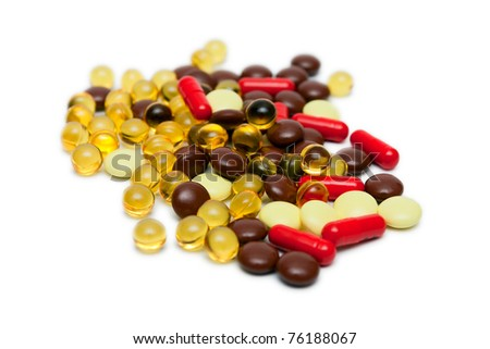 Many Pills and capsules isolated on white