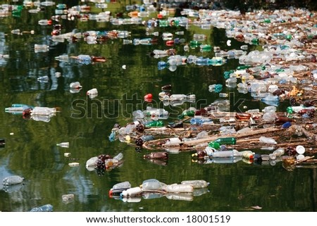 many plastic bottle on lake water