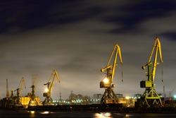 Many port crane in wintertime at night, Saint - Petersburg, Russia