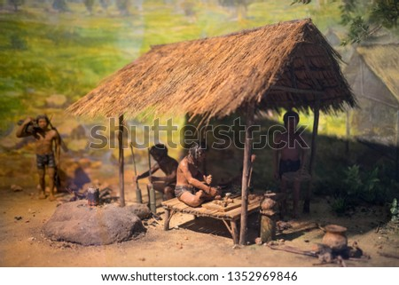 many prehistory wax model living in they home and do something like cooking Stock photo ©