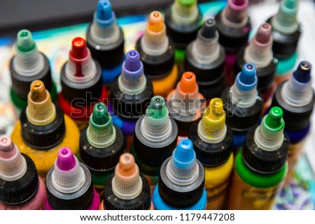 many professional bottles with colored ink for tattoos. tattoo parlor #1179447208