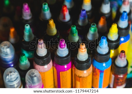 many professional bottles with colored ink for tattoos. tattoo parlor #1179447214