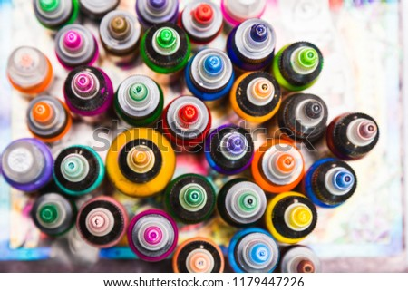 many professional bottles with colored ink for tattoos. tattoo parlor #1179447226