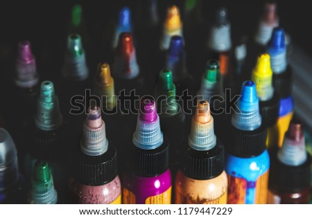many professional bottles with colored ink for tattoos. tattoo parlor #1179447229