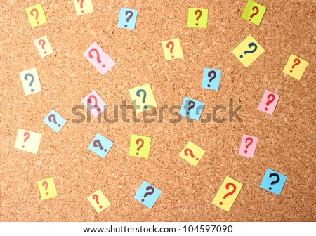 Many question marks on cork board