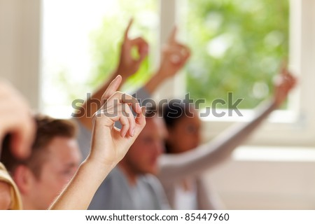 Many raised fingers in class at university Stock photo ©