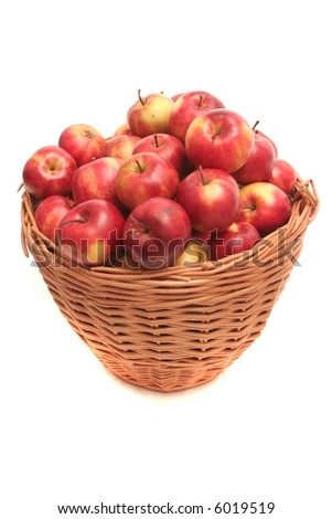 Many red apples lay in a basket on a white background
