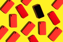 many red cell phones on yellow background. Communication and gadgets. Bright pattern