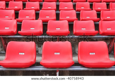 many red seats in a stadium