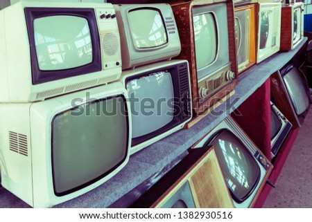 Many retro television. vintage old TV is colorful multi-row. Pattern wall of old Antique television . Media. Rows of old TVs. The first televisions are tube-type  #1382930516