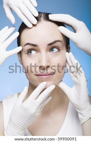 many rubber gloves touching the face of a woman