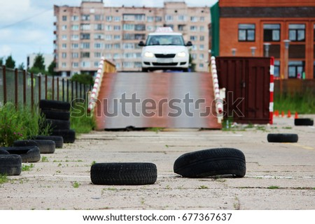 many Rubber tires from wheels are on site for training where drivers learn to ride on cars. The driver completes the entry and exit from the inclined surface #677367637