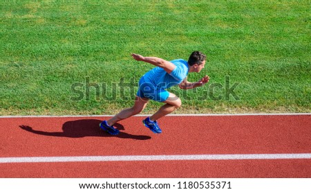 Many runners like challenge of extending their endurance without having to do training necessary to finish marathon. Man athlete run training. Athlete run track grass background. Runner in motion. #1180535371