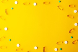 Many scattered pharmaceutical medicine vitamins, pills, fish oil softgel, tablets