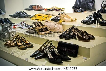 Many shoes and purses on store showcase