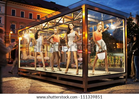 Many shopping women on exhibition window - stock photo