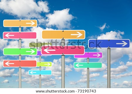 many signs with arrow on White, fluffy clouds in blue sky collage