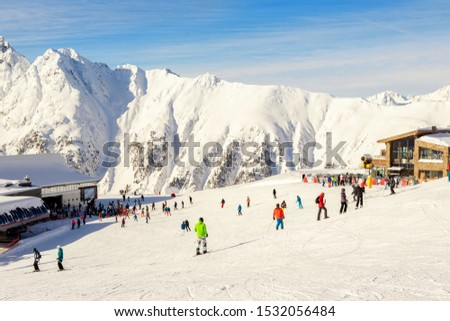 Many skiers and snowboarders riding over Idalp downhill plato at austrian alipine Ischgl resort on briht sunny day at winter. Winter sport outdoor activities and travel concept #1532056484