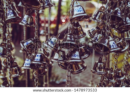 Many small bells for blessings in the temple.