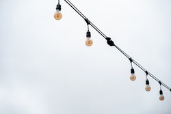 many small bulbs hanging from the wire. urban street decorative lighting
