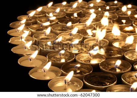many small candlestick encrusted dark shape background - stock photo